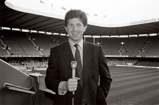 A young Alan Wilkins on assignment at the National Stadium in Cardiff