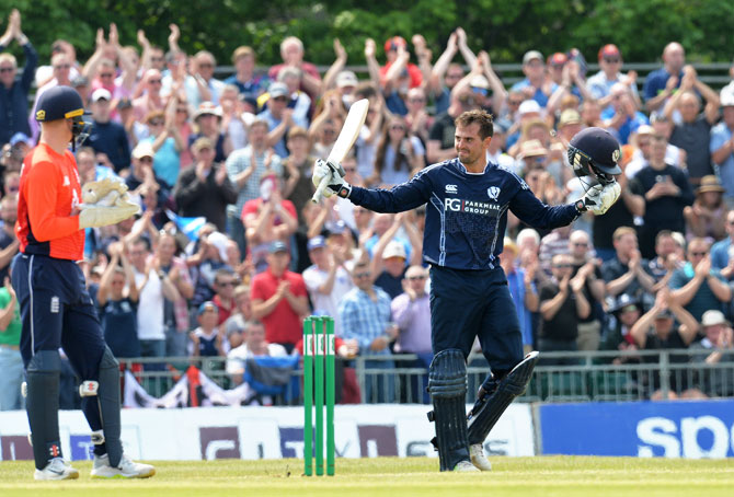 Scotland's Callum MacLeod celebrates his century against England