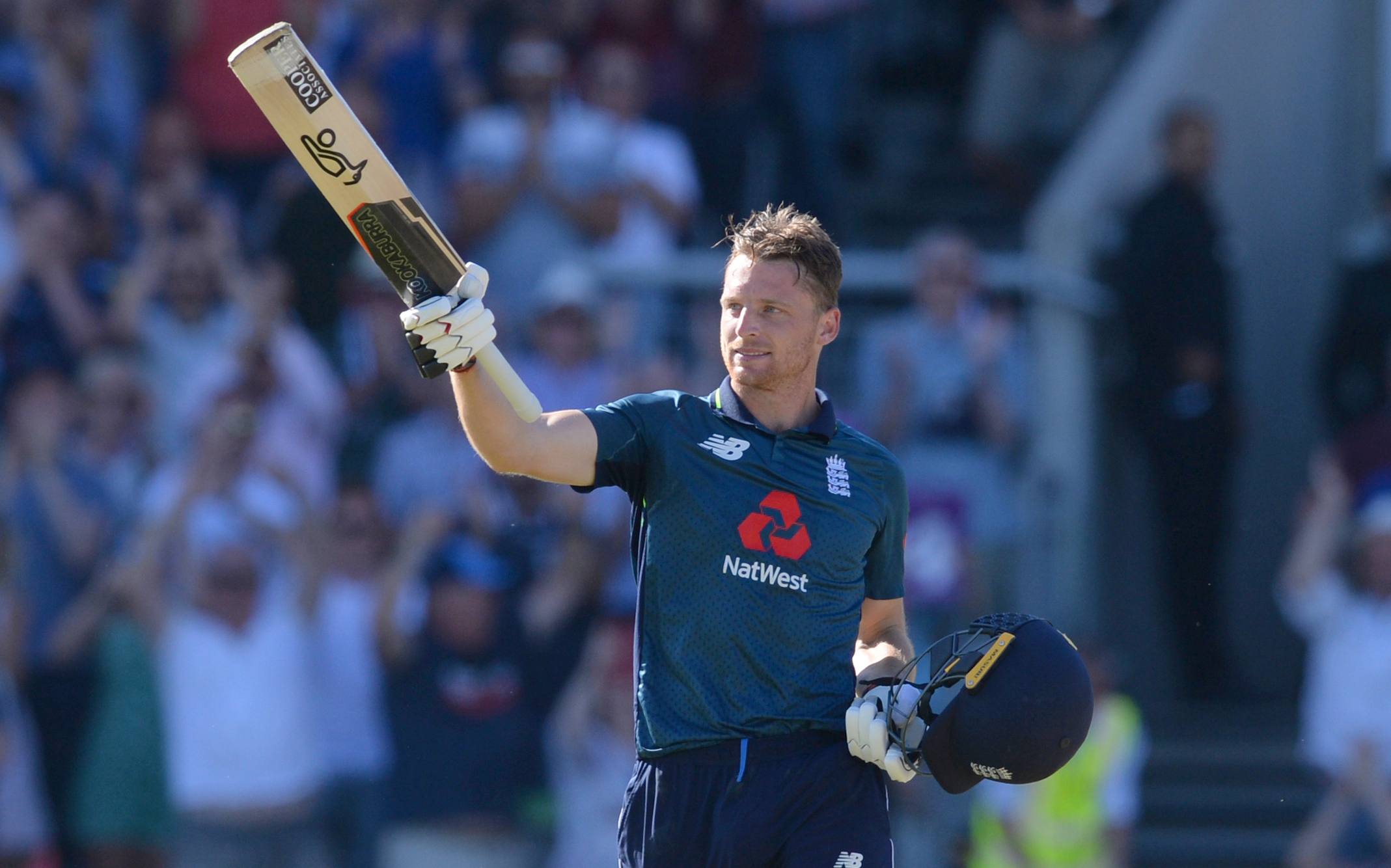 England's Jos Buttler celebrates after hitting the winning runs in the fifth Royal London One-Day International against Australia at Emirates Old Trafford cricket ground in Manchester on Sunday