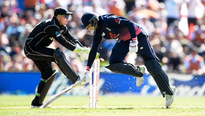England batsman Joe Root makes his ground to reach his century to foil a the run out attempt as New Zealand's Tom Latham whips the bails off