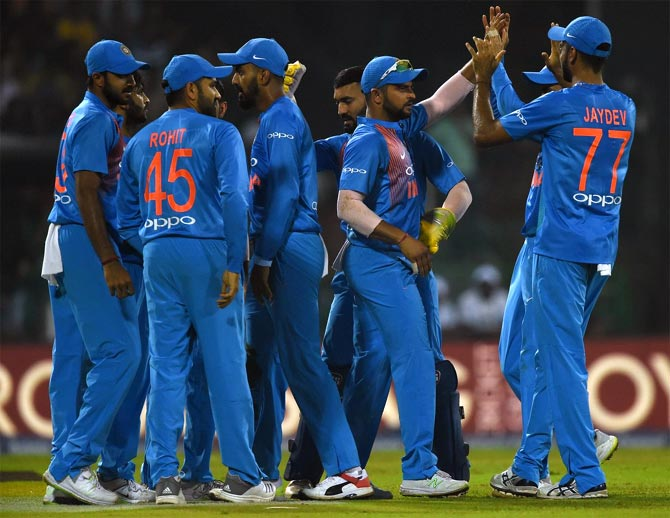 India's players celebrate a wicket during the fourth T20 International against Sri Lanka