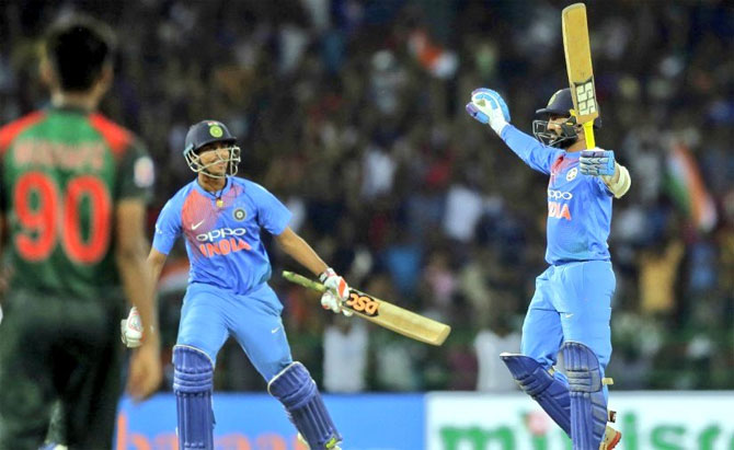 Dinesh Karthik celebrates with Washington Sundar after playing his match-winning six off the last ball