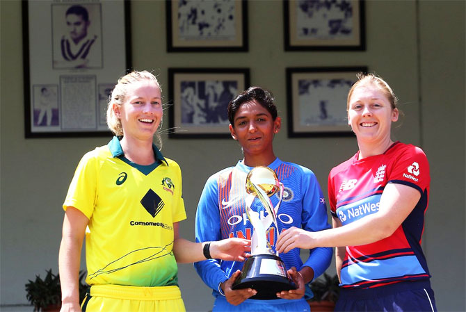 India captain Harmanpreet Kaur is flanked by Australia captain Meg Lanning and England captain Heather Knight as they pose for a photo with the winners trophy ahead of the Womens T20I Tri-series at Brabourne stadium in Mumbai on Wednesday