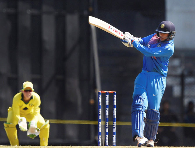 Indian batswoman Smriti Mandhana plays a shot in the opening match against Australia during the Women's T20I Tri-series at Brabourne stadium in Mumbai on Thursday