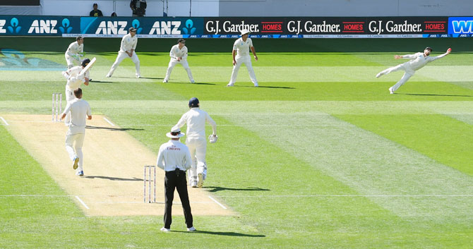 New Zealand captain Kane Williamson dives to take a catch and dismiss England batsman Stuart Broad off the bowling of Tim Southee