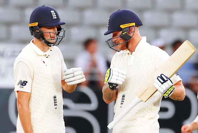 England's Chris Woakes and Ben Stokes during their defiant stand of 83 in almost 31 overs