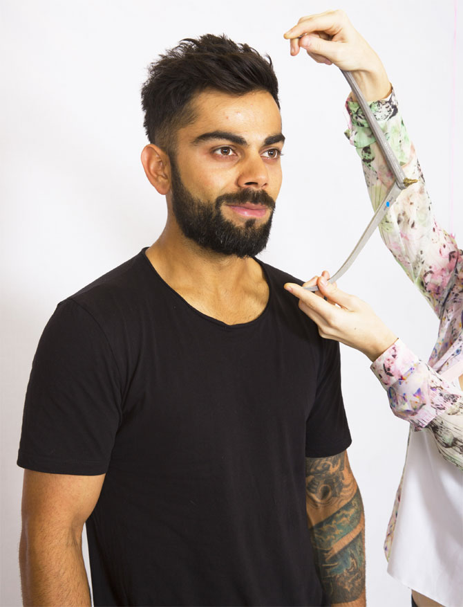 Virat Kohli's face is measured by a Madame Tussuads artist