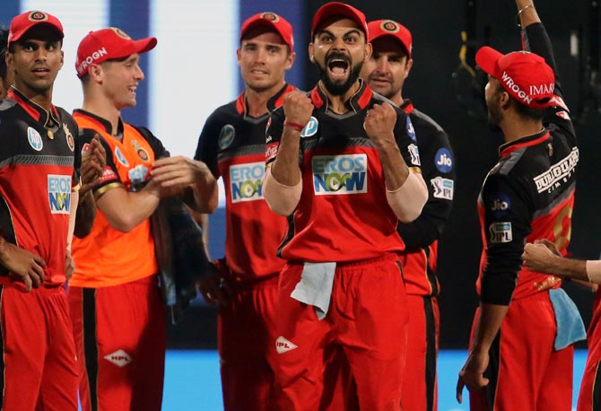 Royal Challengers Bangalore Captain Virat Kohli and his team-mates celebrate Rohit Sharma's wicket. RCB had a morale-boosting win against the Mumbai Indians, May 2, 2018, Photograph: BCCI