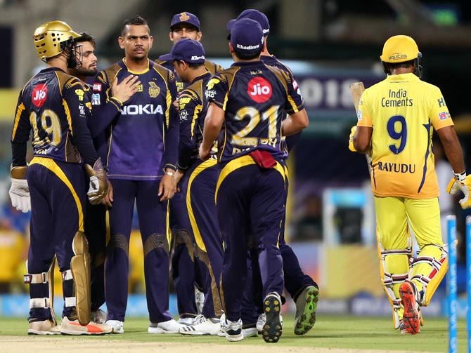 Sunil Narine is congratulated by his KKR teammates after dismissing Shane Watson