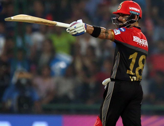 IPL PHOTOS: Kohli, de Villiers keep RCB's hopes alive