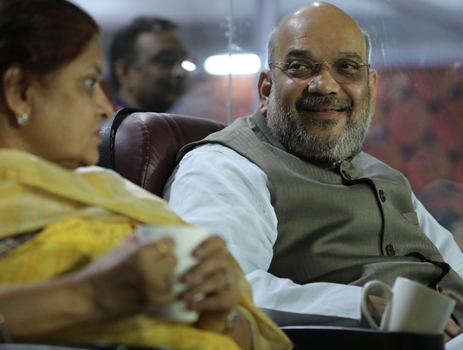 Rediff Cricket - Indian cricket - PIX: On Karnataka poll day, Amit Shah enjoys IPL game