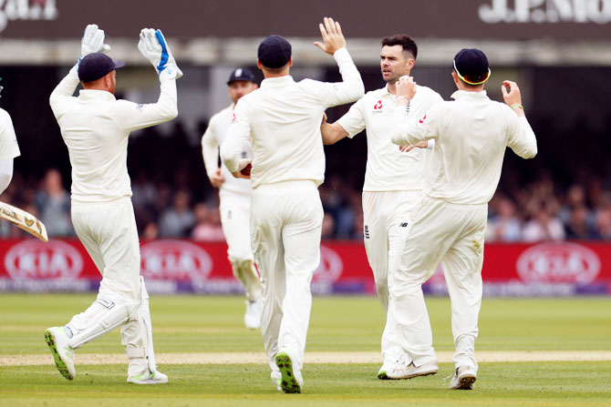 England's James Anderson celebrates with teammates after taking the wicket of Pakistan's Azhar Ali