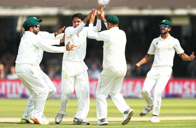Pakistan's Mohammad Abbas celebrates the wicket of England's Alastair Cook
