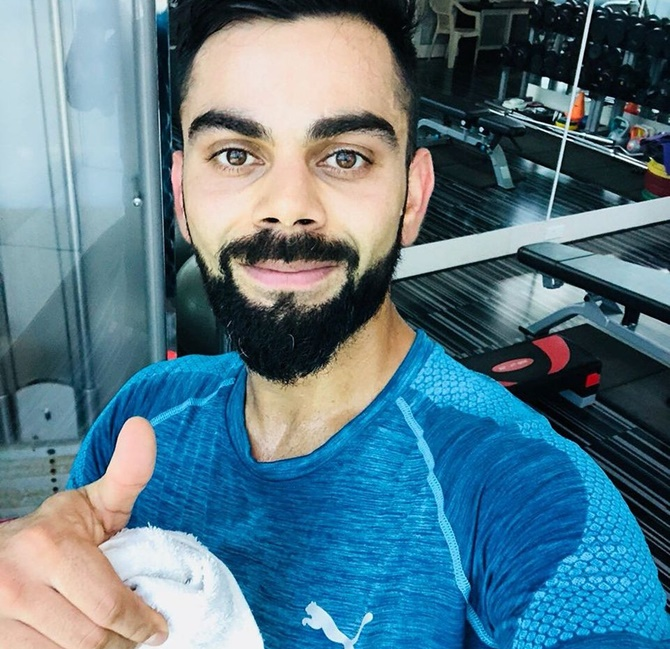 Rediff Cricket - Indian cricket - Injured Kohli 'can't do weights yet but can run'