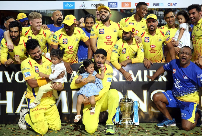 CSK's Suresh Raina and Harbhajan Singh with their children at the presentation ceremony the IPL final
