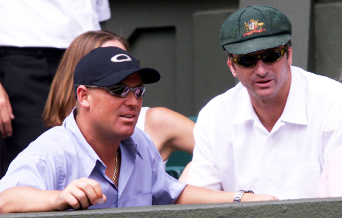 Shane Warne and Steve Waugh, wearing the Baggy Green' watch the 2001 Wimbledon final between compatriot Patrick Rafter and Croatia's Goran Ivanisevic
