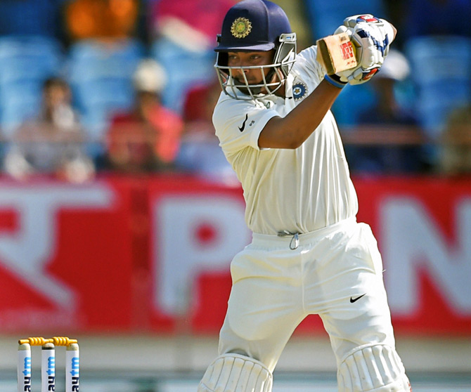 Prithvi Shaw hits a boundary on the way to his 100. Photograph: PTI
