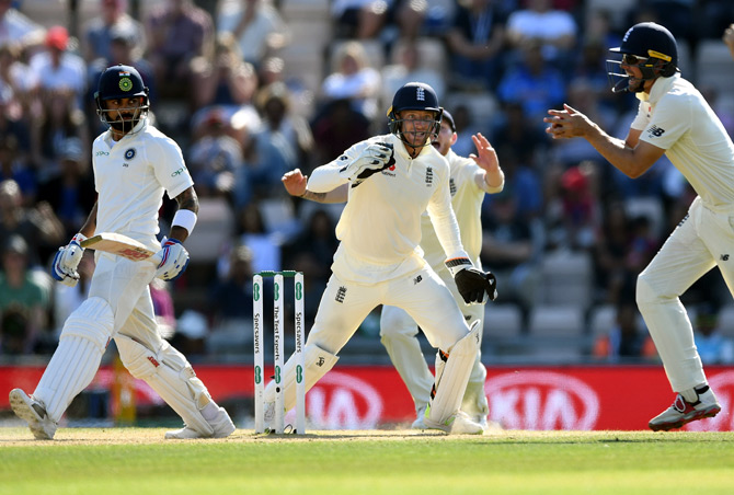 Virat Kohli is caught by Alastair Cook at short leg off Moeen Ali's bowling, beginning the Indian slide into defeat in the Southampton Test. Photograph: Gareth Copley/Getty Images