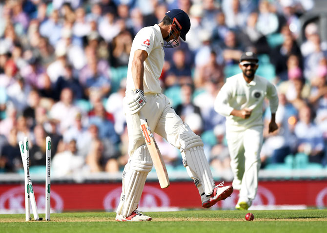 Alastair Cook reacts after being bowled by Jasprit Bumrah after his knock of 71