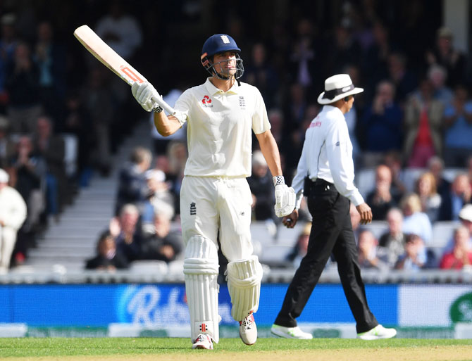 Alastair Cook acknowledges the crowd on completing his half-century