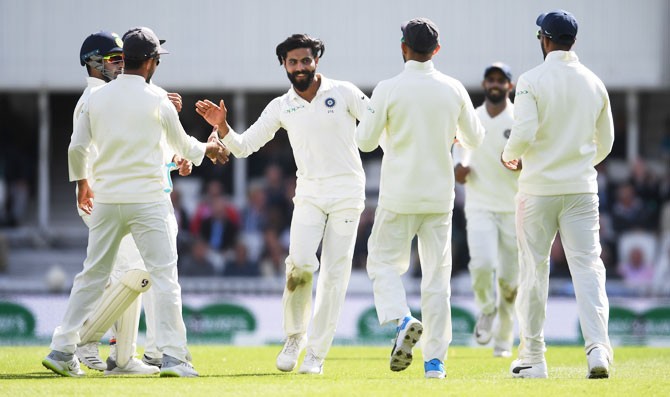 Ravindra Jadeja celebrates with teammates after dismissing Keaton Jennings