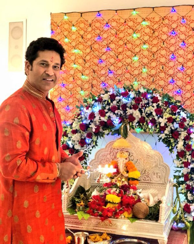Former India captain Sachin Tendulkar performs Ganesh aarti at his residence