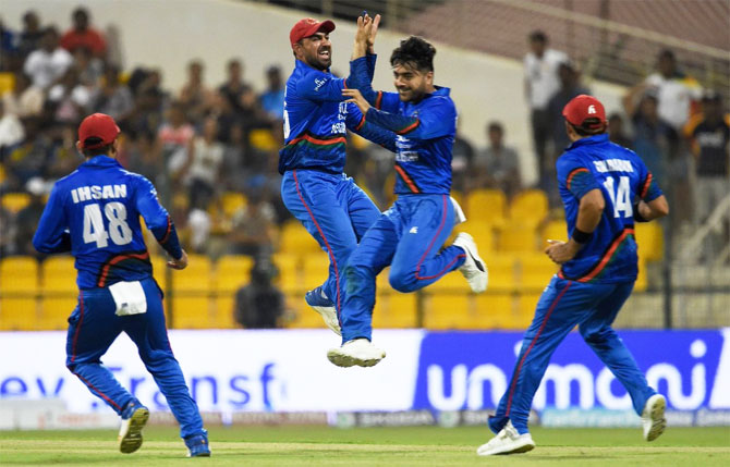 Rediff Sports - Cricket, Indian hockey, Tennis, Football, Chess, Golf - Asia Cup PIX: Sri Lanka knocked out after shock loss to Afghanistan