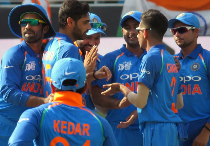 Rediff Sports - Cricket, Indian hockey, Tennis, Football, Chess, Golf - PHOTOS: Bowlers shine as India demolish Pakistan