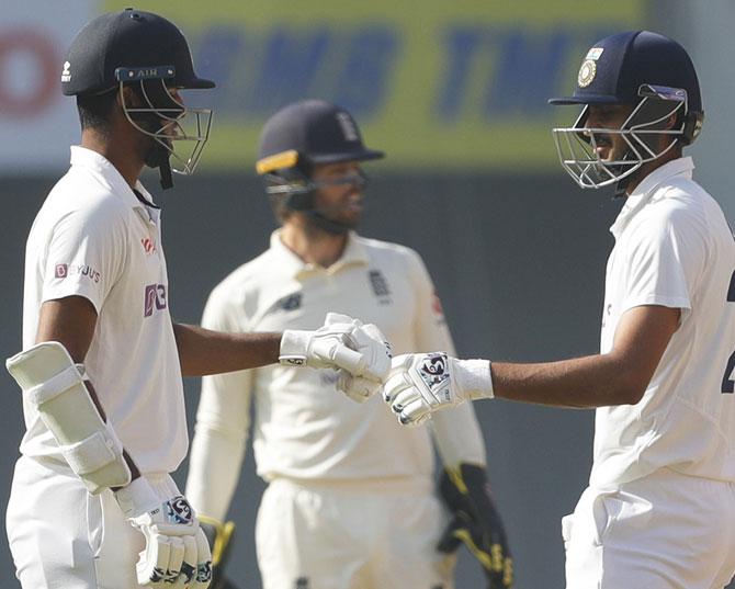Sundar, Axar take India past 300