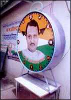 Ajit Pawar smiles through the party symbol