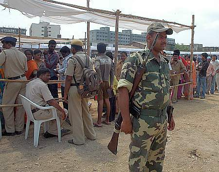 Paramilitary soldier stands guard at a polling booth