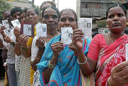 Women voters show their Voter ID cards
