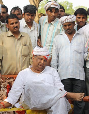Kirori Lal Meena relaxes at a compaign meeting in Geejgad