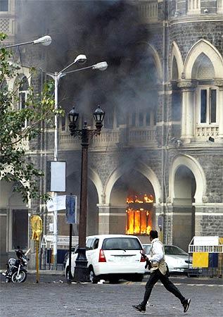 Smoke billows out of Mumbai's Taj Mahal hotel during the siege by terrorists