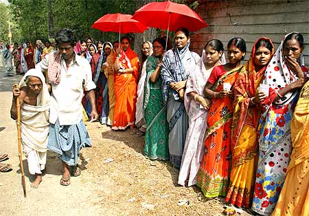 A woman is helped to a polling station to cast her ballot in Nandigram, about 150 km southwest of Kolkata, May 6, 2009