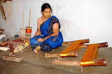 A disenchanted weaver at her home