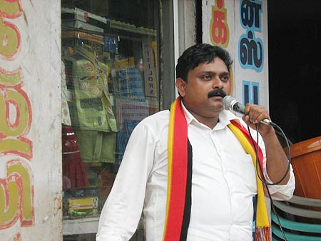 A DMK worker canvasses for his candidate in Kanyakumari
