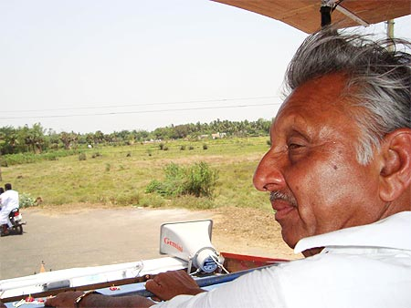 Congress candidate from Mayiladuthurai Mani Shankar Aiyar surveys his constituency from atop his campaign vehicle