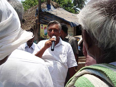 At meetings Aiyar is clad in the simple white dhoti-shirt of his constituency and speaks Tamil