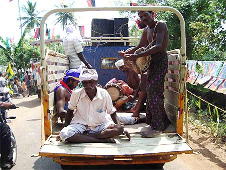 A van carrying folk performers, part of Aiyar's campaign