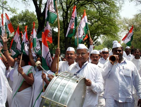 Congress party workers celebrate in New Delhi