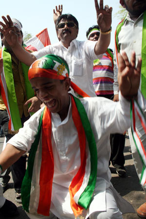 Congress workers celebrate in New Delhi