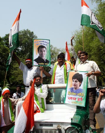 Congress workers participate in a victory rally