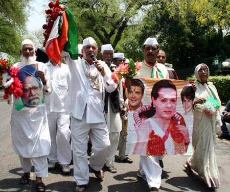 Congress workers celebrate outside Congress headquarters in New Delhi
