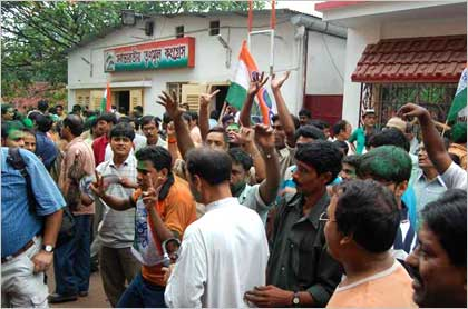 Trinamool supporters celebrate outside Mamata's residence