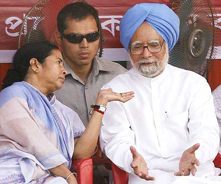 Dr Singh in conversation with Trinamool Congress party chief Mamata Banerjee