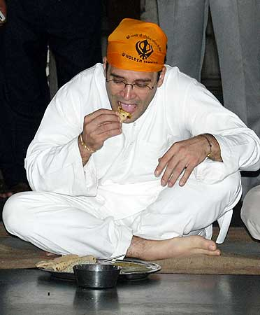Rahul eats at a community kitchen after paying homage at the Golden Temple in Amritsar