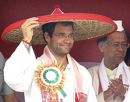 Rahul wears a japi -- a traditional bamboo sun shade -- during a rally in Kharupetia, near Guwahati