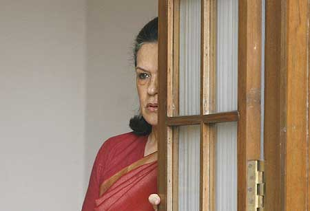 Congress president Sonia Gandhi awaits Prime Minister Manmohan Singh at her home soon after the election results were known on May 16