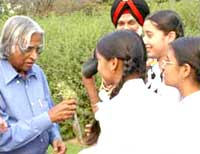 President Kalam takes school children on a tour of his herbal garden